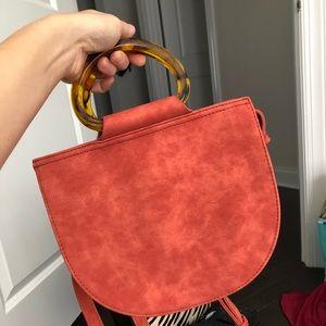 Super chic orange faux suede bag